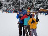 happy people in the midle of ski lessons with ski school from poiana brasov